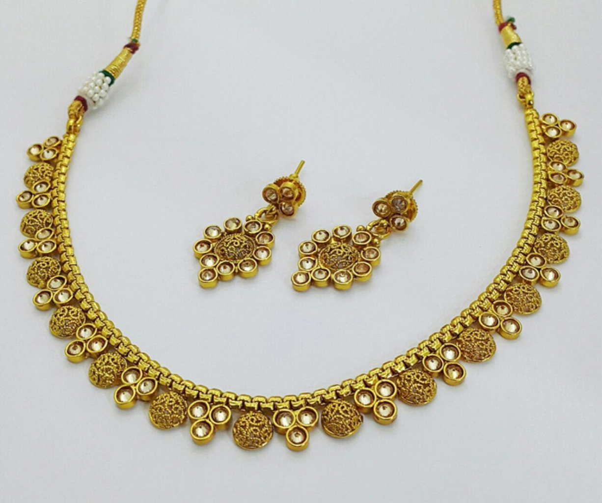 15028355060_Golden-base-polki-necklace-set-1650.jpg